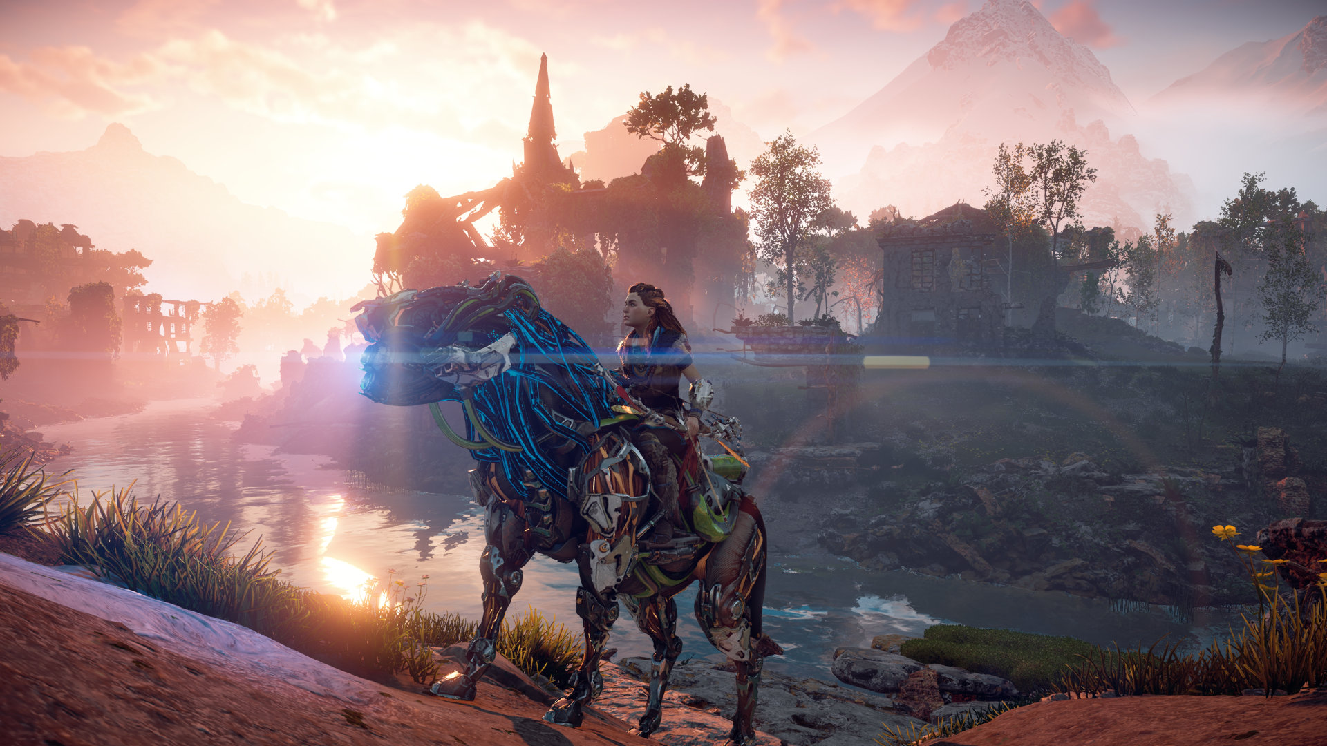 Screen shot from the game Horizon Zero Dawn, showing the hero, Aloy, mounted on a mechanical steed overlooking ruins and a river at sunrise.
